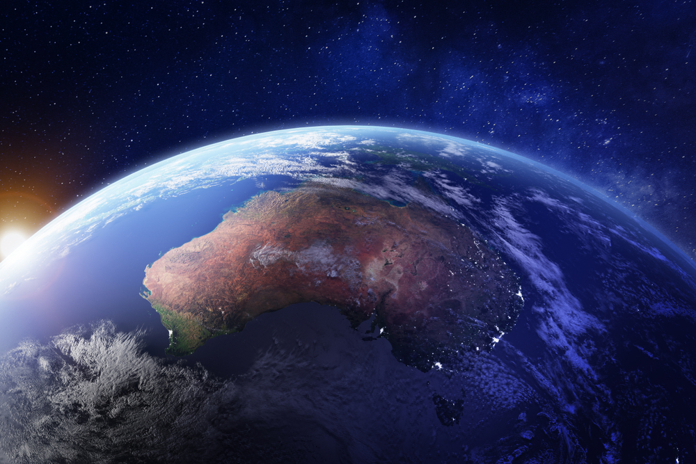 Earth showing Australia from space with cities lit up