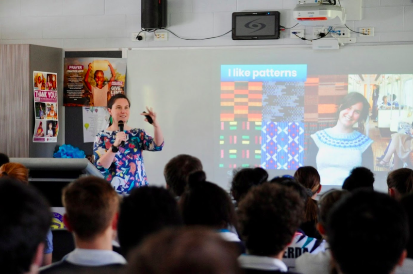 Helen speaking to students at a school