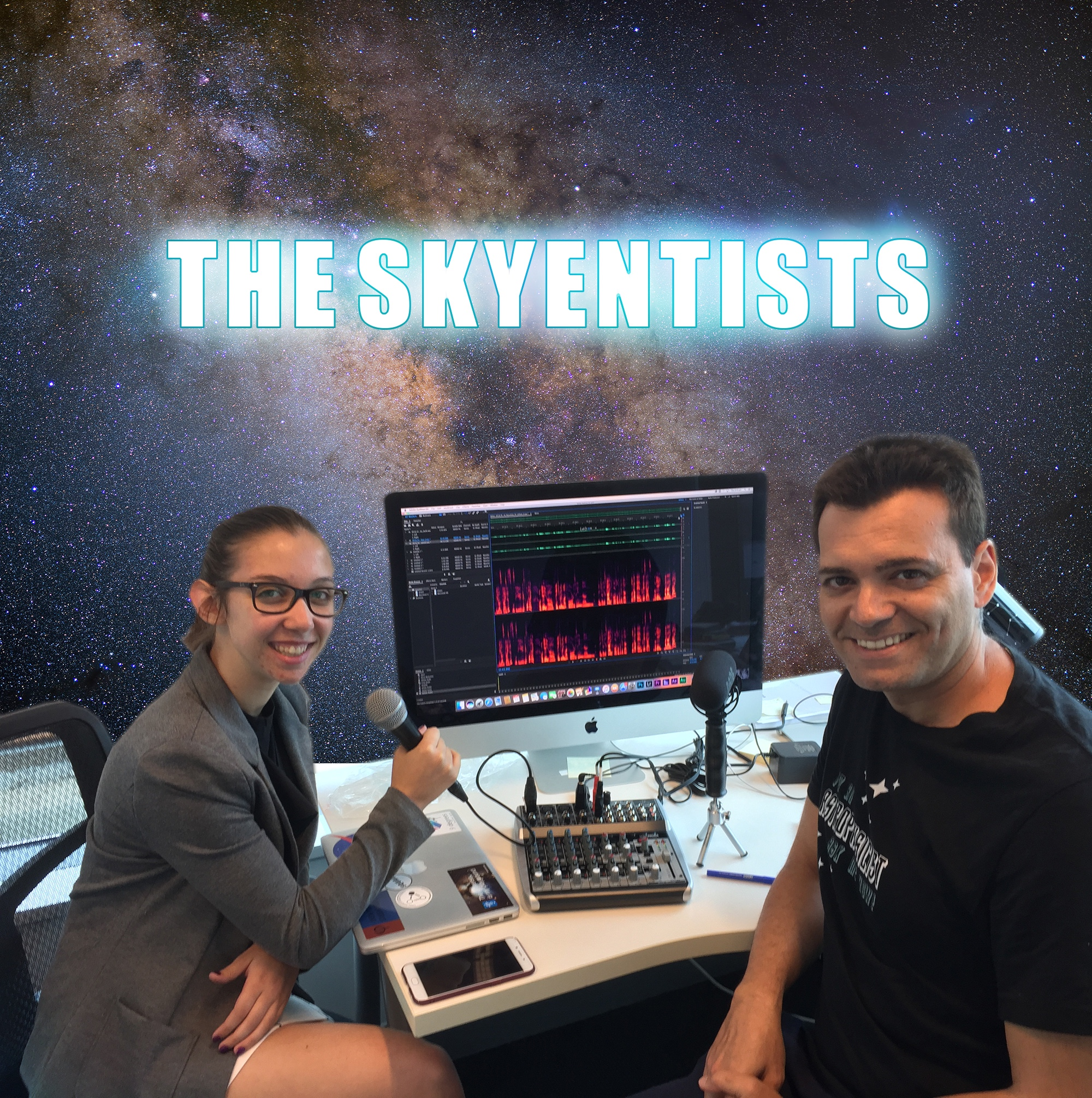 The Skyentists featuring Ángel and Kirsten sitting in front of a computer recording the podcast