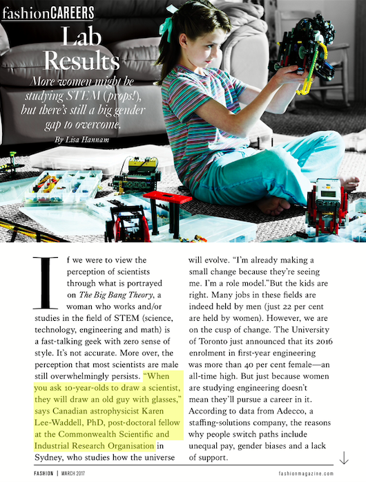 Screenshot of article, showing a young woman sitting on floor looking into constructed pieces of robotic materials.