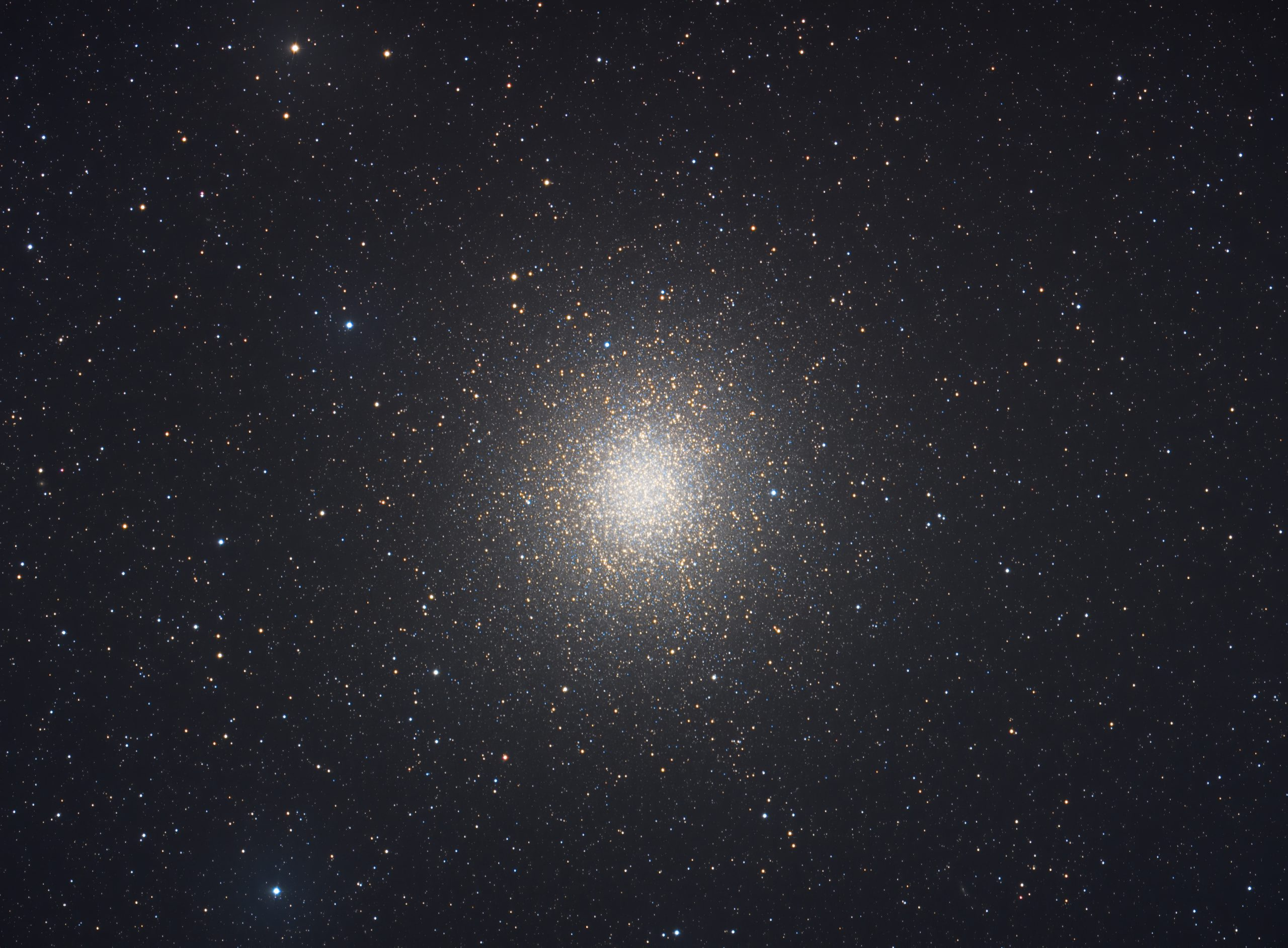 Globular cluster of stars showing concentration of white and yellow stars at centre in a sphere like structure with it dispersing into more tenitical like structures moving away from the centre.