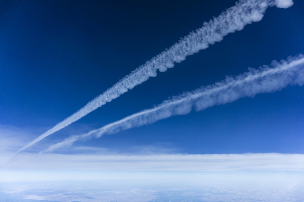 Two contrails from an aircraft that has passed in the blue sky.