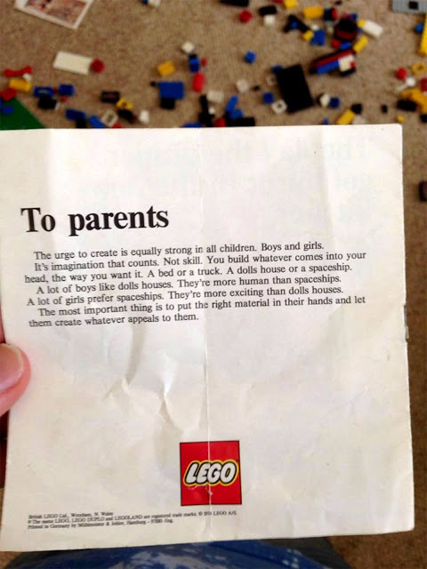 image of a note from the company lego held up in someone's hand