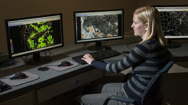 Woman sitting at computer looking at satellite images