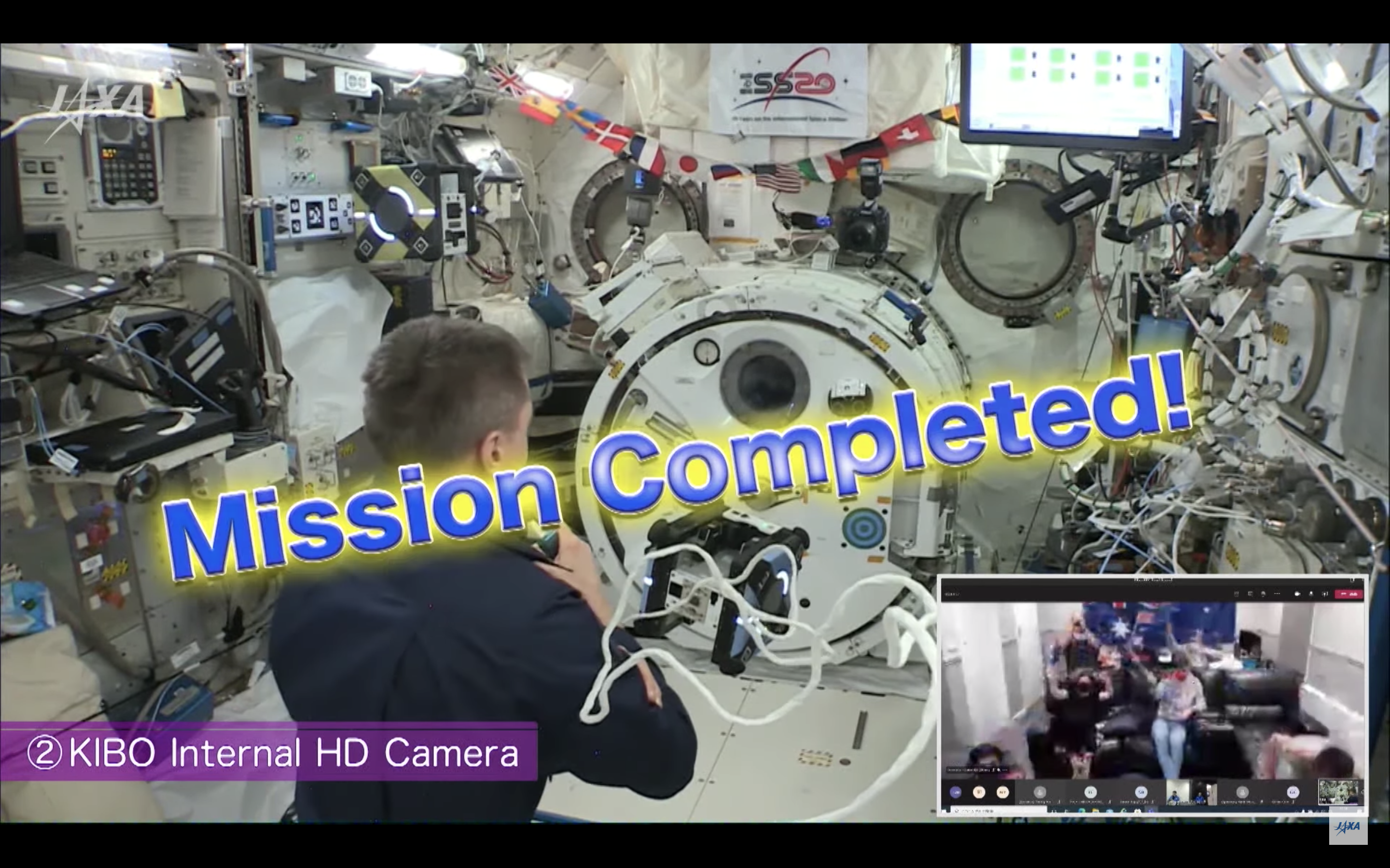 Screenshot of video linkup with Commander Cassidy and Astrobee, with words Mission Completed