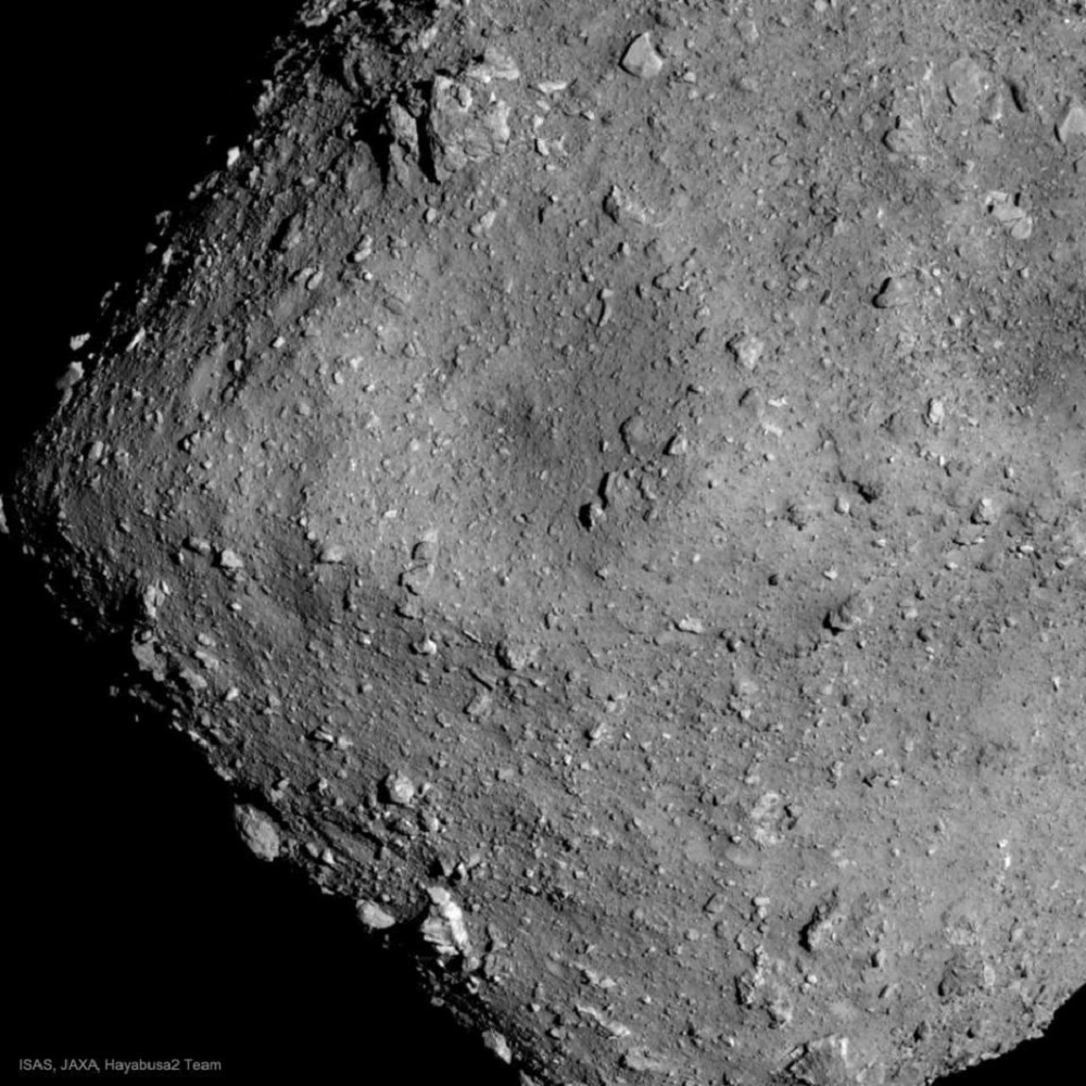 A rocky asteroid, with lots of rubble on the surface and an oddly truncated shape
