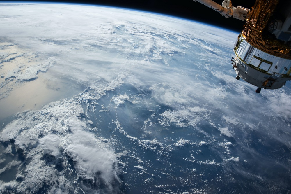 Image of Earth taken from space station showing blue globe with clouds