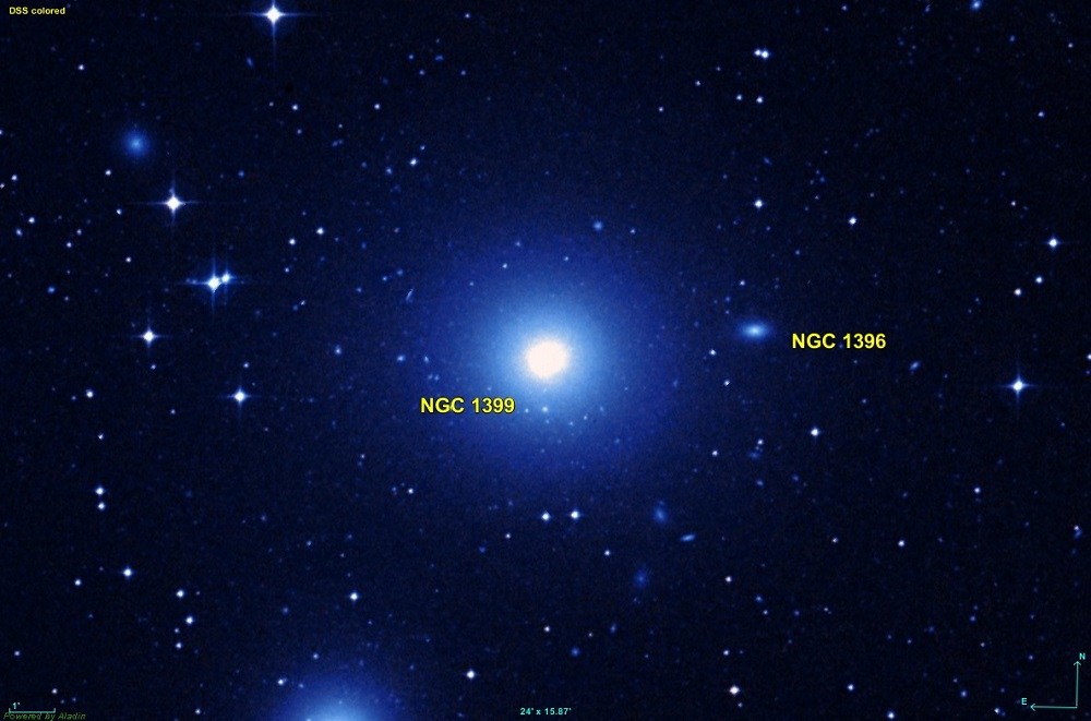 A blue elliptical galaxy at the centre of the image which is annotated, along with a smaller oval galaxy on the right also annotated.